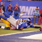 New York wide receiver Hakeem Nicks reaches across the goal line to score a touchdown against the Packers in East Rutherford, N.J. The Giants routed Green Bay 38-10.