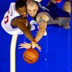 The 76ers' Lavoy Allen and the Suns' Marcin Gortat go up for a rebound in Philadelphia on Nov. 25. Allen's Sixers prevailed, 104-101.