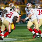 In an early-season matchup between two of the NFC's best, visiting San Francisco -- known the previous season for its top-ranked defense -- outperformed the high-powered Green Bay offense led by reigning league MVP Aaron Rodgers. Niners' QB Alex Smith played mistake-free and threw two touchdown passes, connecting with seven receivers on 20-of-26 passing. Meanwhile, tailback Frank Gore rushed for 112 yards and a score on just 17 carries. Notably, 49ers' kicker David Akers matched the longest field goal in NFL history with a 63-yarder to end the first half.
