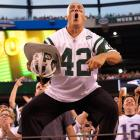 """New York Jets superfan Fireman Ed Anzalone, who has led the famous """"J-E-T-S"""" cheer for decades, has decided to call it quits. In a guest column for  New York Metro , Anzalone explains how confrontations with other Jets fans led to his decision. While Jets supporters mourn the loss of their biggest booster, SI looks at other famous sports superfans, past and present."""