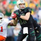After losing four games in a row in October, Baylor closed out the regular season on a hot streak. The Bears won four of their final five games, including Saturday's high-scoring victory over Oklahoma State. Nick Florence (pictured) threw for 296 yards, Tevin Reese amassed 108 receiving yards and a score and Lache Seastrunk paced the running attack with 178 yards and a touchdown. Junior linebacker Eddie Lackey recorded a pick-six for the second consecutive week.