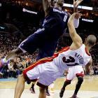 Shane Battier draws a charging foul against the Bobcats' Bismack Biyombo during a  Dec. 26 game. Miami won, 105-92.