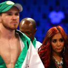 """TV personality Nicole """"Snooki"""" Polizzi, who recently entered the boxing promotion business, stands with Patrick Hyland before Hyland's fight on the Pacquiao-Marquez undercard. (Her appearance  caused some confusion  on the Twittersphere.)"""