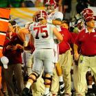 AJ McCarron was all smiles as he celebrated with star center Barrett Jones. Jones is widely considered the top center prospect for the 2013 NFL Draft.