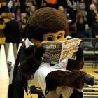 The game was such a blowout that this mascot couldn't tear his eyes away from the shopping circular.