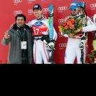 Forgetting that he's no longer active, former alpine ski star Alberto Tomba, 46, attempted to order himself up a medal in Bornio to the obvious amusement of Italy's Dominik Paris (center) while Hannes Reichelt of Austria ponders the spoils of victory.