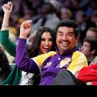 A strange man had the ex-Mrs. Kobe on his arm while watching her former hubby battle the Knicks on Christmas Day in Los Angeles.