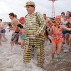 Bet you can just imagine Brooklyn Decker decked out in Metrocards, like this hunk of beefcake in the waters off Brooklyn's Coney Island (Brooklyn the borough, not Brooklyn the swimsuit model) where the Polar Bear Club's annual splash in the icy Atlantic attracts hundreds of certifiably insane individuals.