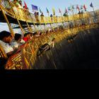 A daredevil enthralls the crowd at a fair in Mumbai, India, where stunt drivers on motorbikes and cars go around and around and around on the vertical walls and, if the name of the event is to believed, no one gets down alive.