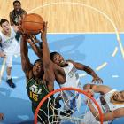Utah Jazz power forward Derrick Favors fights for a rebound with Denver Nuggets small forward Kenneth Faried during a Jan. 5 matchup in Denver. The Nuggets defeated the Jazz 110-91.