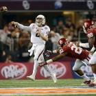 Texas A&M quarterback Johnny Manziel throws on the run as he evades Oklahoma linebacker Frank Shannon during the Cotton Bowl. Manziel backed up his Heisman season, throwing for 287 yards and rushing for 229 with four  touchdowns as the Aggies defeated the Sooners 41-13.