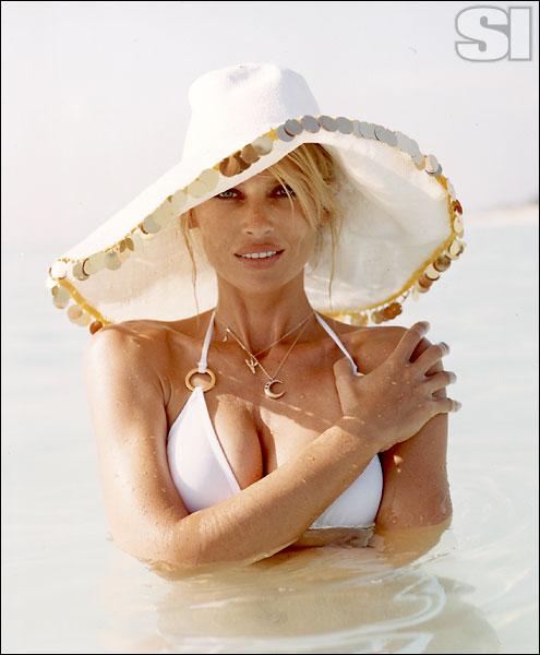Patricia Underwood (hat), Luli Fama (suit)
