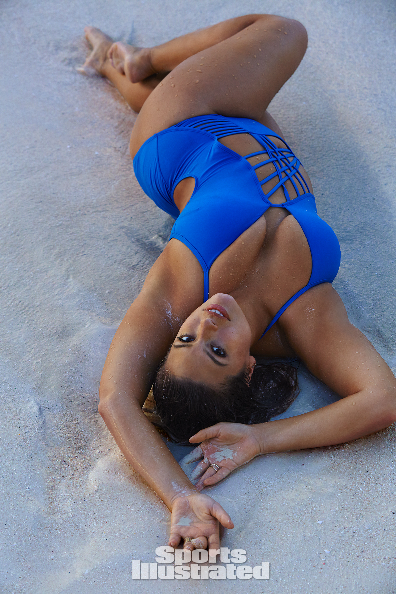 Ashley Graham was photographed by James Macari in Turks & Caicos. Swimsuit by Kenneth Cole Swimwear.