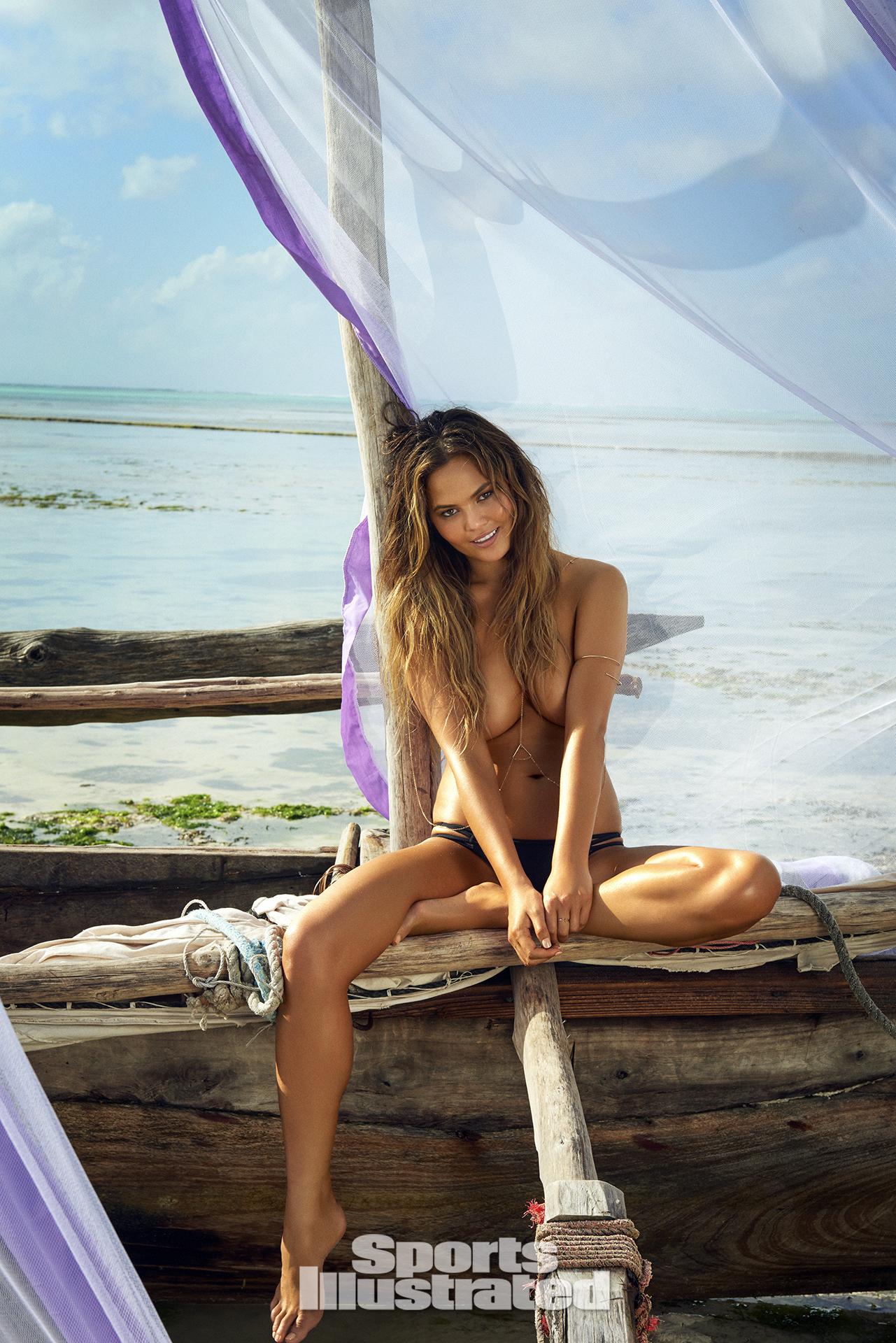 Chrissy Teigen was photographed by Ruven Afanador in Zanzibar. Swimsuit by MIKOH.