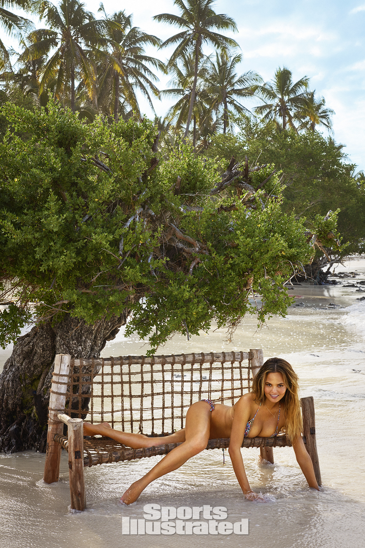 Chrissy Teigen was photographed by Ruven Afanador in Zanzibar. Swimsuit by PHAX.