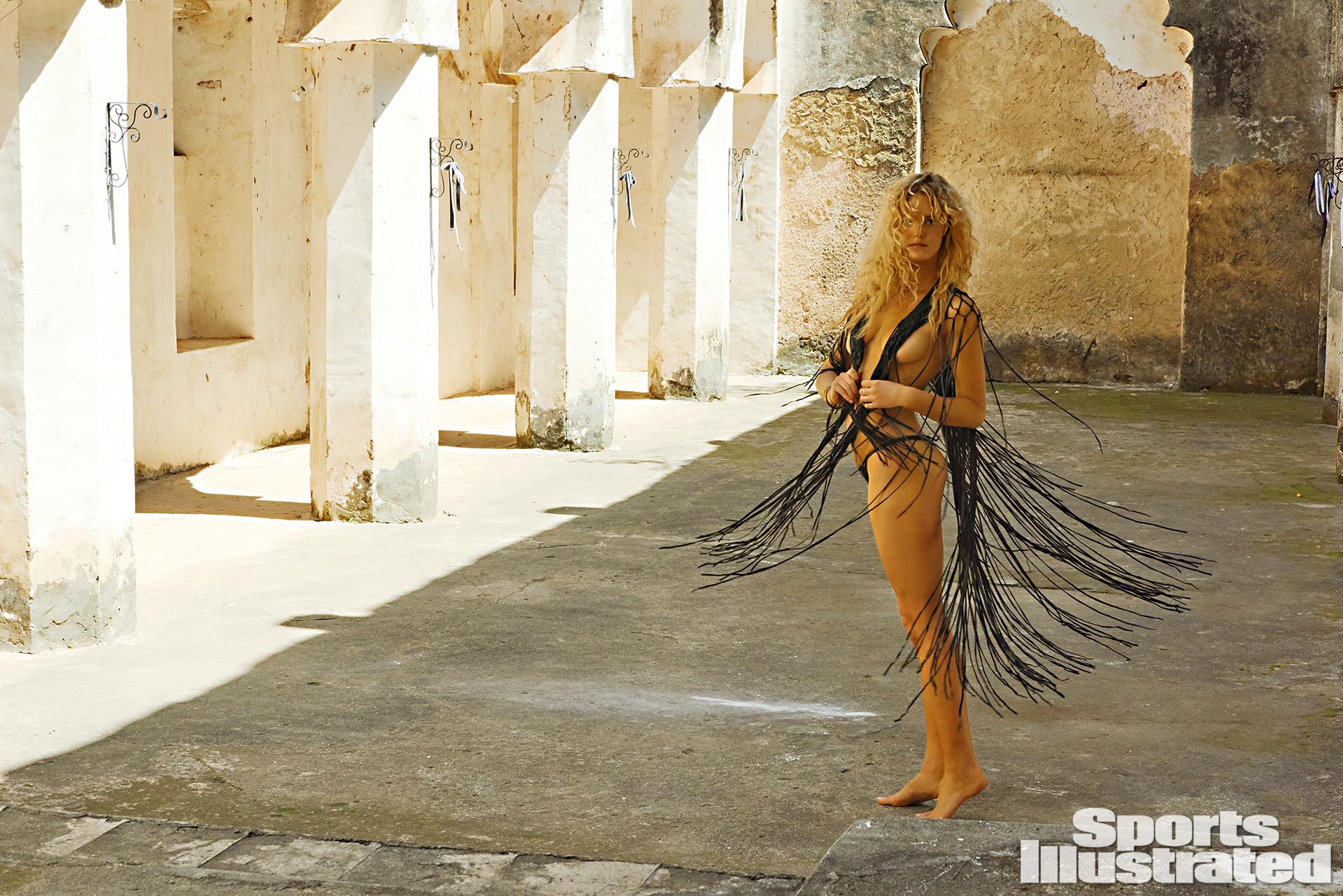 Erin Heatheron was photographed by Ruven Afanador in Zanzibar. Top by Lost Art by Jordan Betten. Swimsuit by INDAH.