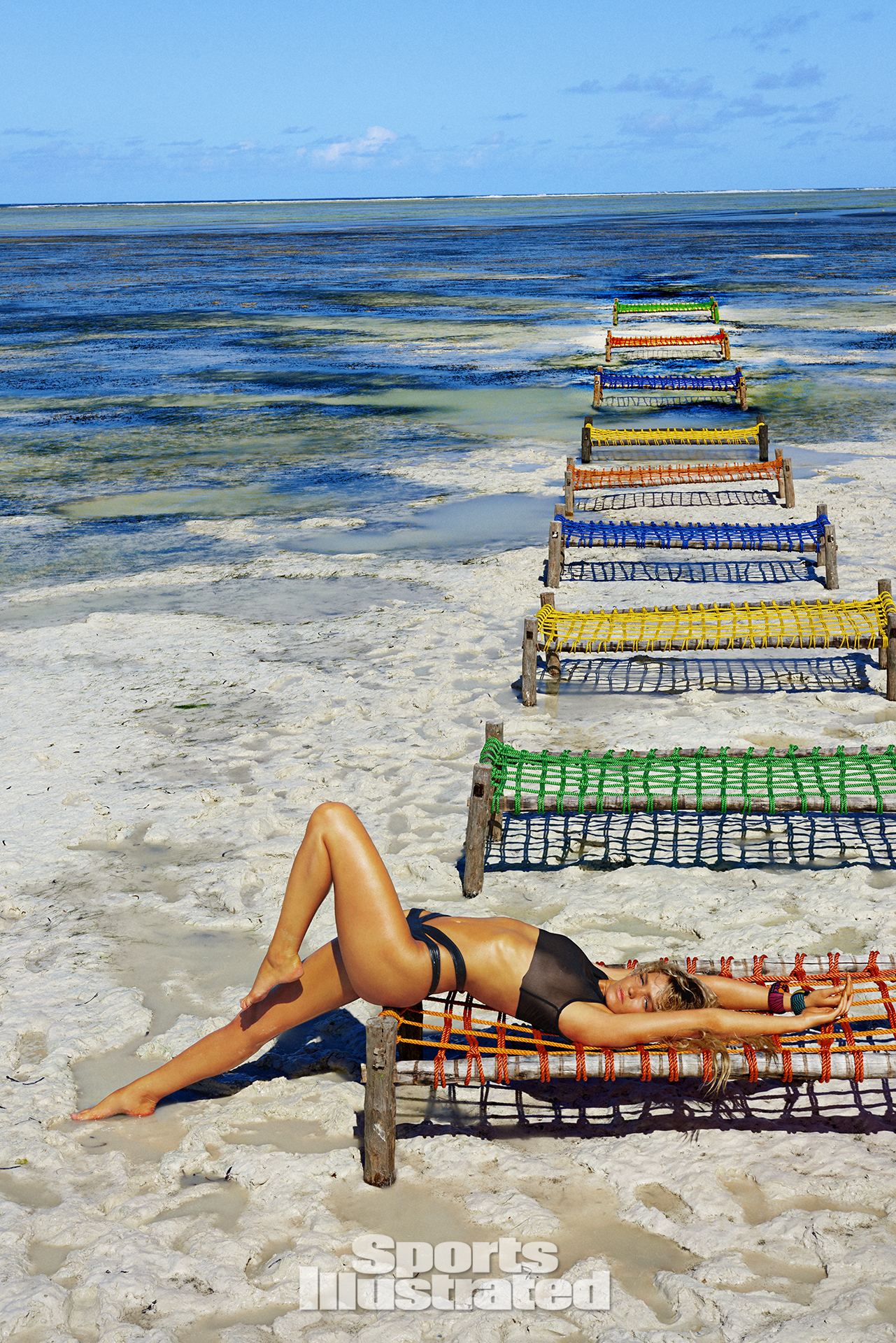 Erin Heatheron was photographed by Ruven Afanador in Zanzibar. Top by Rachel Pally. Swimsuit by Minimale Animale.