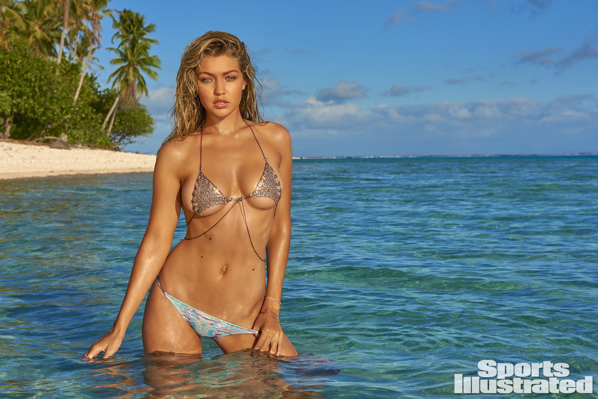 Gigi Hadid was photographed by Yu Tsai in the Islands of Tahiti. Top by LITTER. Swimsuit by MALIA JONES.