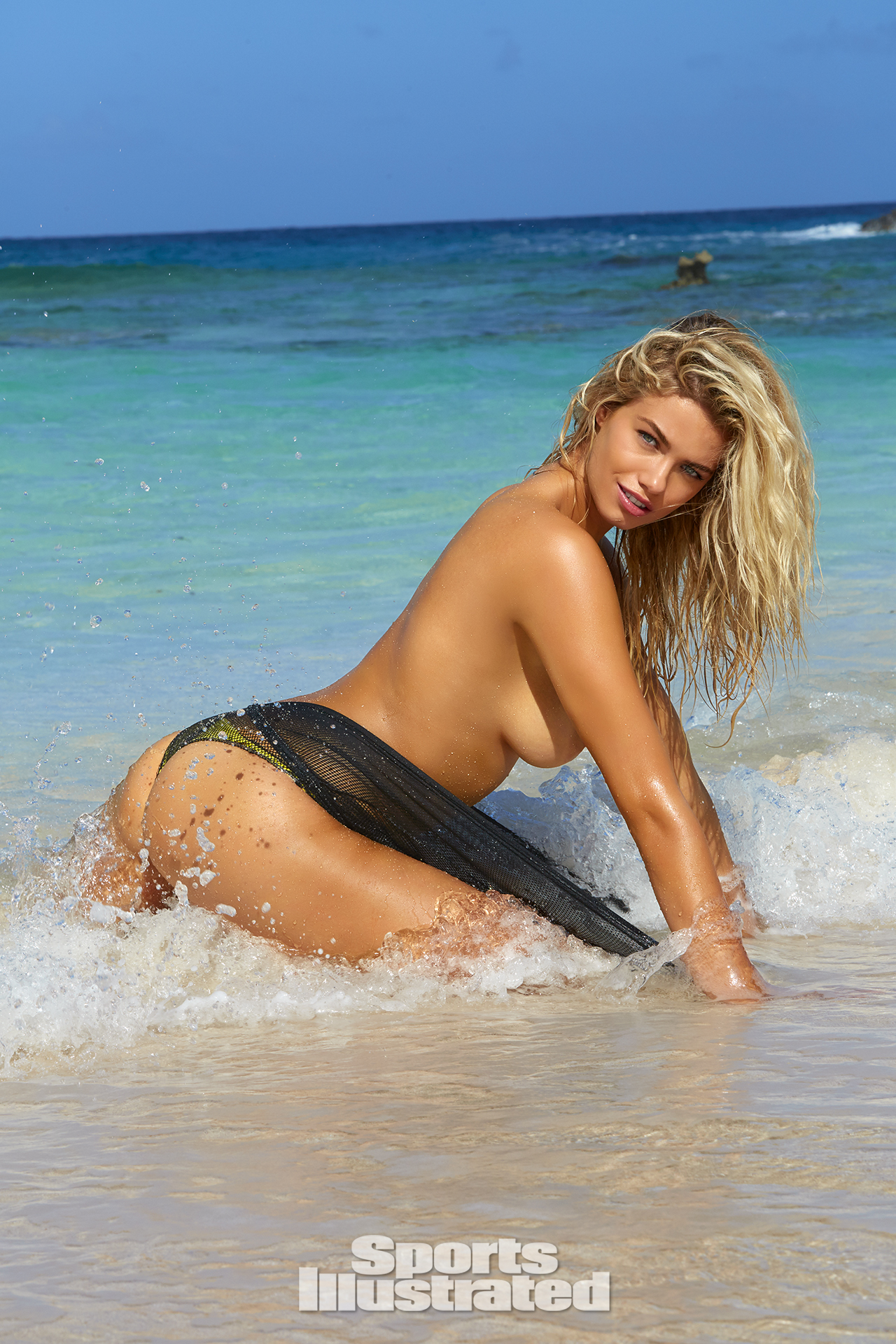 Hailey Clauson was photographed by James Macari in Turks & Caicos. Top by Diesel. Swimsuit by Noe Garments