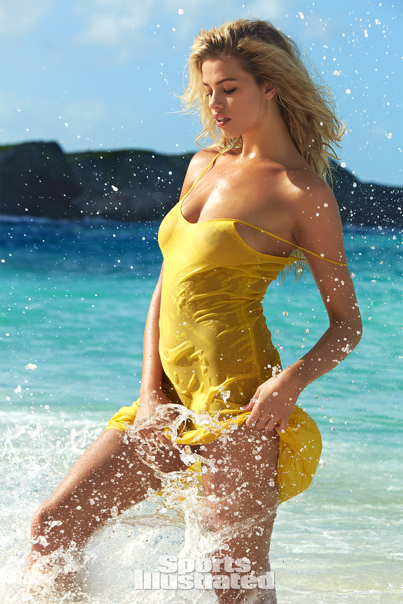 Hailey Clauson was photographed by James Macari in Turks & Caicos. Dress by Krisana Sotelo