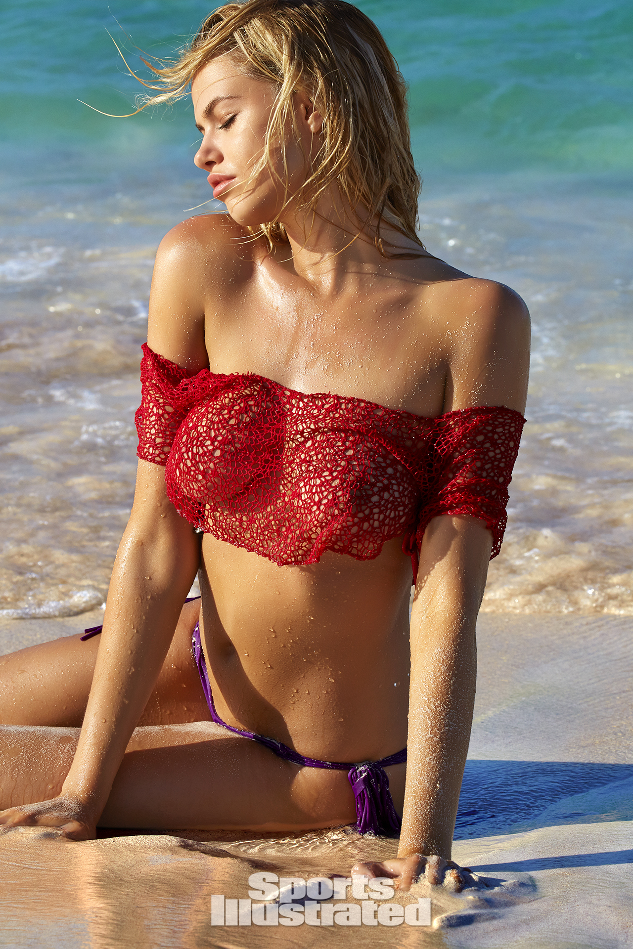 Hailey Clauson was photographed by James Macari in Turks & Caicos. Top by Heidi Fish. Swimsuit by MIKOH.