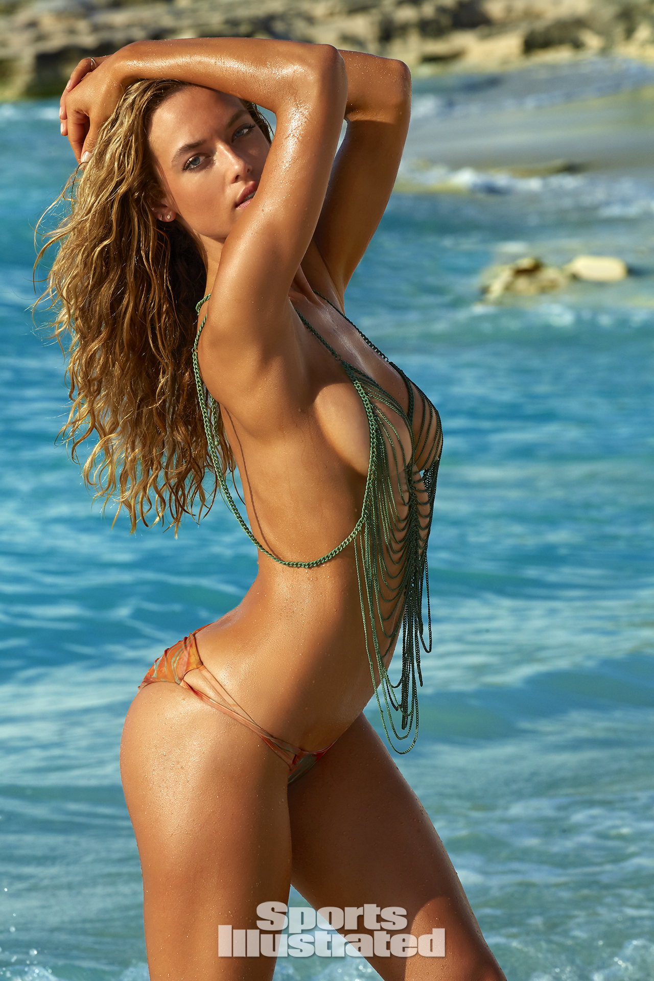 Hannah Ferguson was photgraphed by James Macari in Turks & Caicos. Top by Maggie May Swimwear. Swimsuit by Blue Life Swim.
