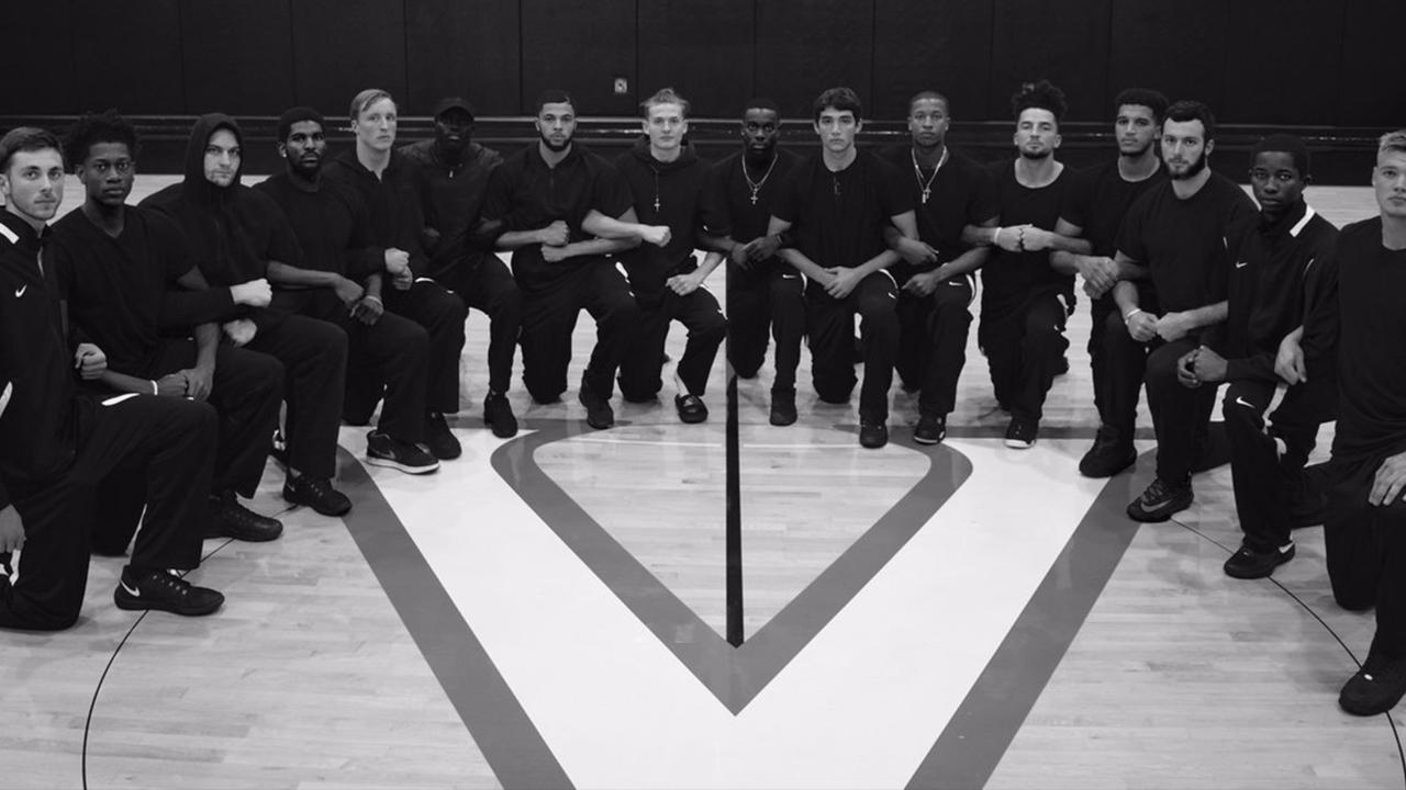 Virginia basketball team 'kneels for injustice'