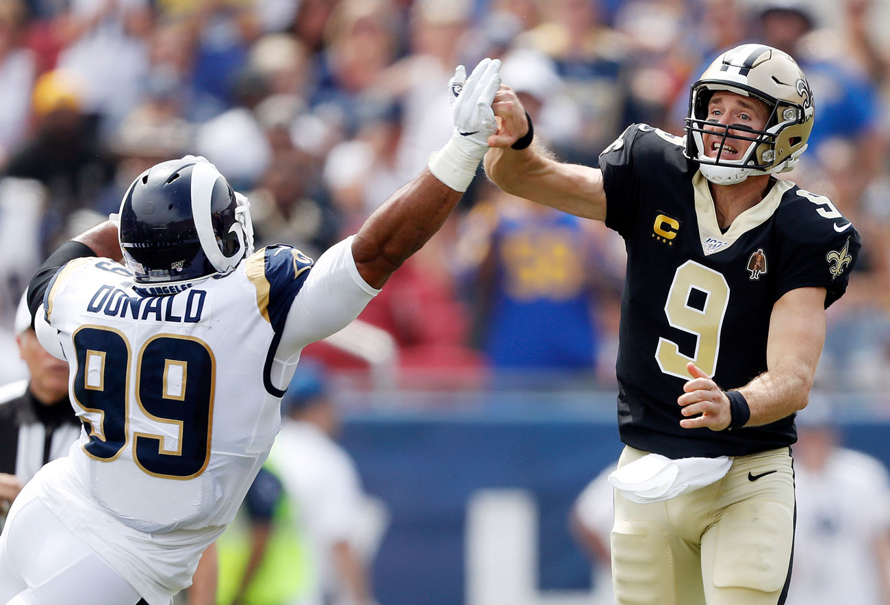 Drew Brees and Aaron Donald hit hands in the Saints-Rams game.
