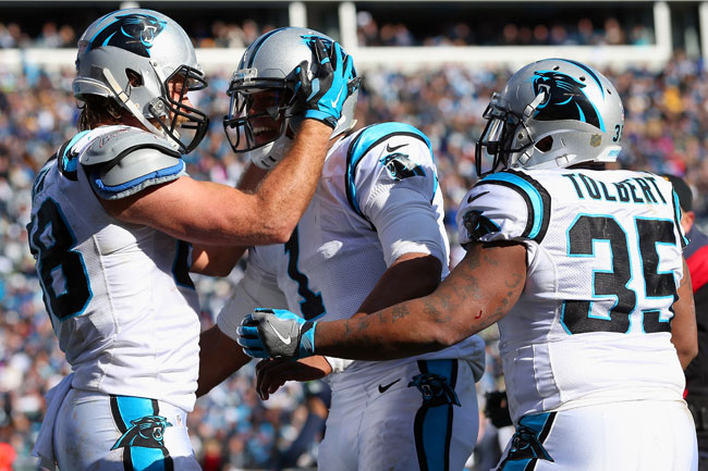 Greg Olsen (l.), Cam Newton and Mike Tolbert celebrate after a touchdown against the Seahawks in the divisional round.