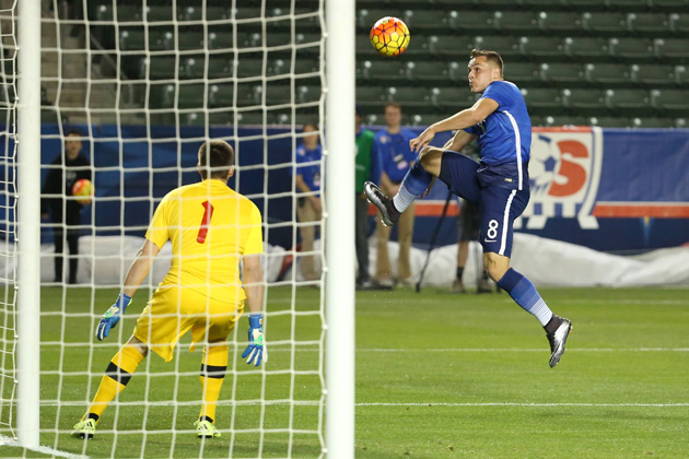 USA's Jordan Morris tries to direct a ball on frame against Canada