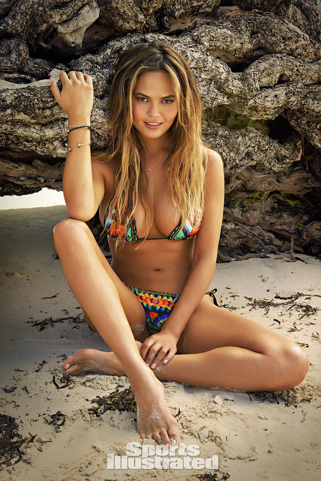 Chrissy Teigen was photographed by Ruven Afanador in Zanzibar. Swimsuit by Agua Bendita Swimwear.