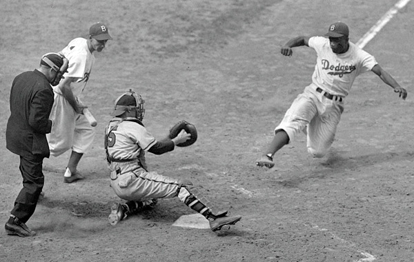 Jackie Robinson performing his signaure play -- a steal of home -- in 1948. (AP)