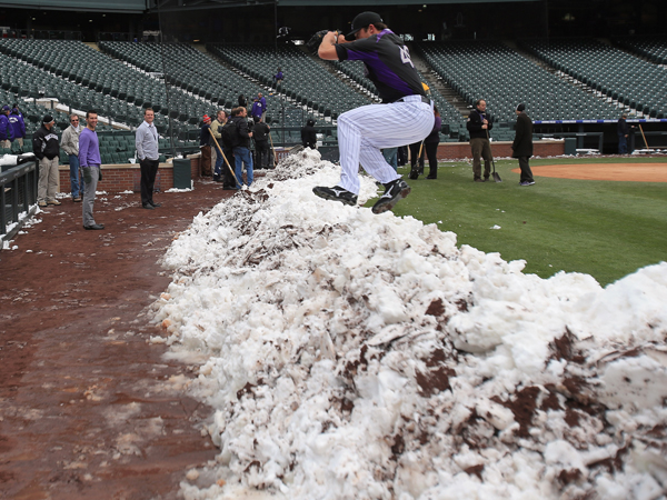 Rockies pitcher  Rex Brothers enjoy some fun in the snow. (AP)