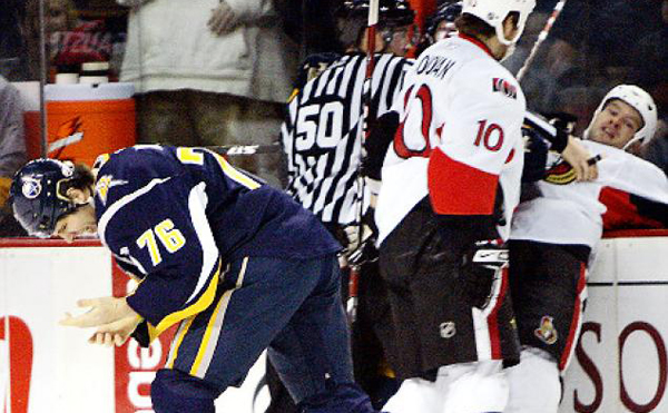 Ottawa's Jarkko Ruutu picked up a fine and a suspension for biting the finger of Buffalo's Andrew Peters.