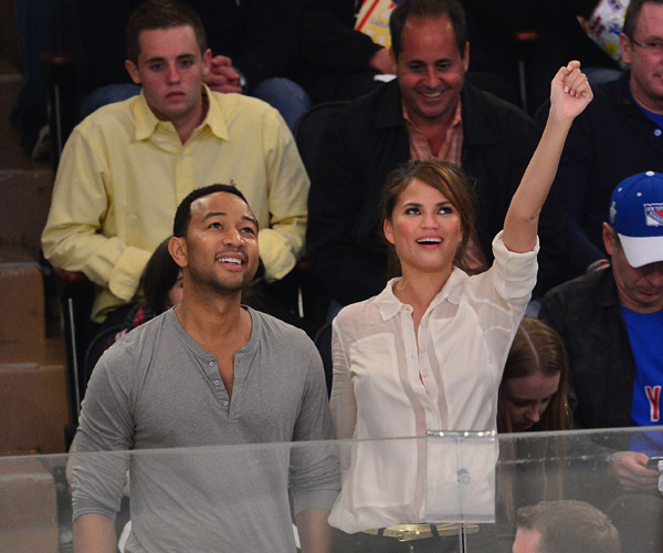 John and Chrissy cheer on the Rangers during a game at MSG last May ::  James Devaney/WireImage
