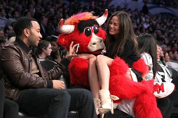 Benny the Bull takes a seat on Chrissy's lap during the 2011 NBA All-Star Game ::  Jeff Gross/Getty Images