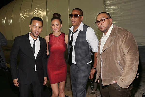 John and Chrissy pose with Jay-Z, and Timbaland at a party the night before the Super Bowl :: Christopher Polk/Getty Images
