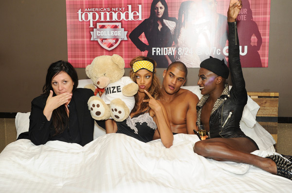 "Kelly Cutrone, Tyra Banks, Rob Evans and Jonte get into bed together at the  ""America's Next Top Model: College Edition, Cycle 19"" Premiere in New York City. (Craig Barritt/Getty Images)"