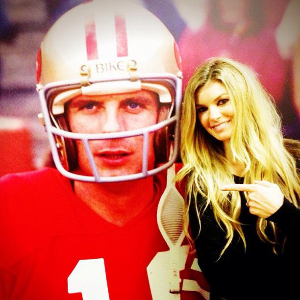 Marisa poses next to a Joe Montana poster :: @marisamiller