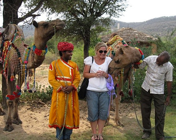 Swimsuit editor MJ Day helps decorate a camel while traveling in India for the 2010 issue.