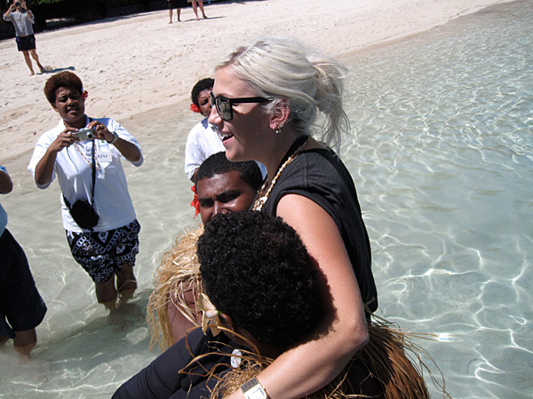 Makeup artist Tracy Murphy is carried from the seaplane during a 2010 photo shoot in Fiji.