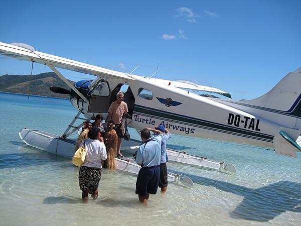 The seaplane lands in Turtle Island, Fiji.