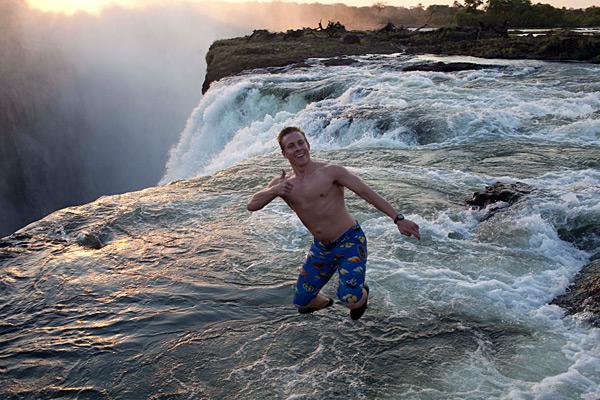 Digital tech Alex Verron jumps into Victoria Falls' Devils Pool in Zambia, 2012 issue.