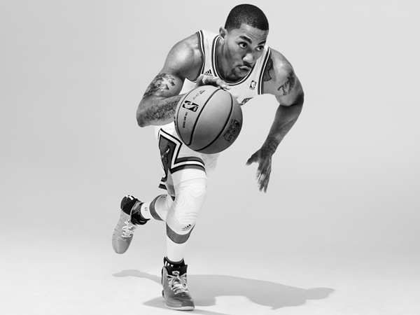 "Bulls guard Derrick Rose models the gray home colorway of the ""D Rose 4,"" his latest signature shoe by Adidas. (Adidas)"