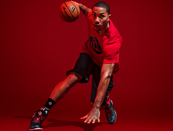 "Bulls guard Derrick Rose models the black road colorway of the ""D Rose 4,"" his latest signature shoe by Adidas. (Adidas)"