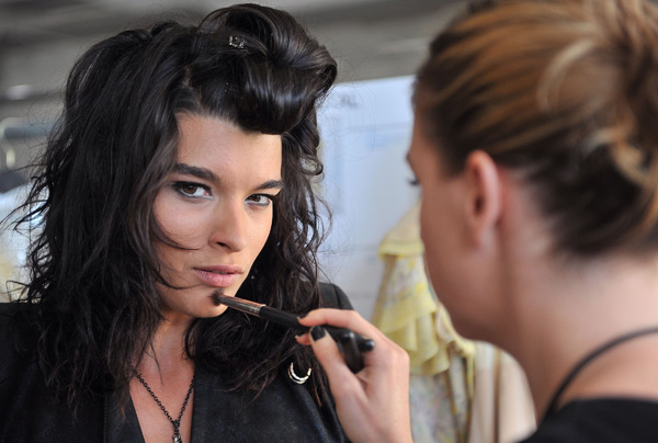 Crystal Renn prepares backstage at the Zac Posen show at Center 548. (Photo by Henry S. Dziekan III/WireImage)