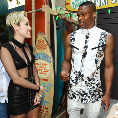 Russell Westbrook (right) and Miley Cyrus  tried to out-shock each other at the Teen Choice Awards. (Jason LaVeris/Getty Images)
