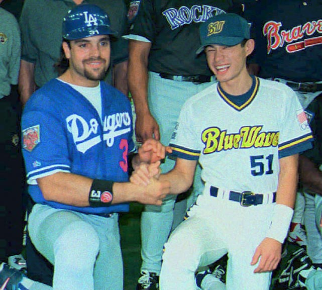 Ichiro, pictured here in 1996 with Mike Piazza,  turns 40 today. (AP)