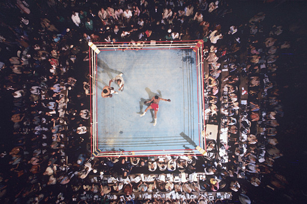 """On this day in 1974, Muhammad Ali regained his heavyweight title by knocking out George Foreman in the famous """"Rumble in the Jungle."""" (Neil Leifer/SI)"""