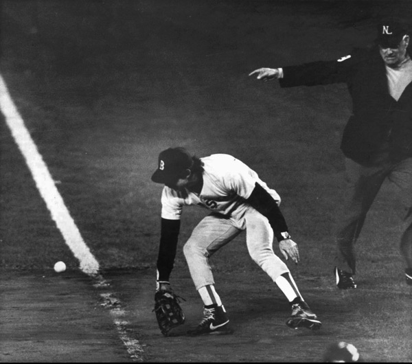 On this day in 1986, Bill Buckner made one of the most infamous plays in sports history when he let this ball go between his legs during Game 6 of the World Series. (AP)